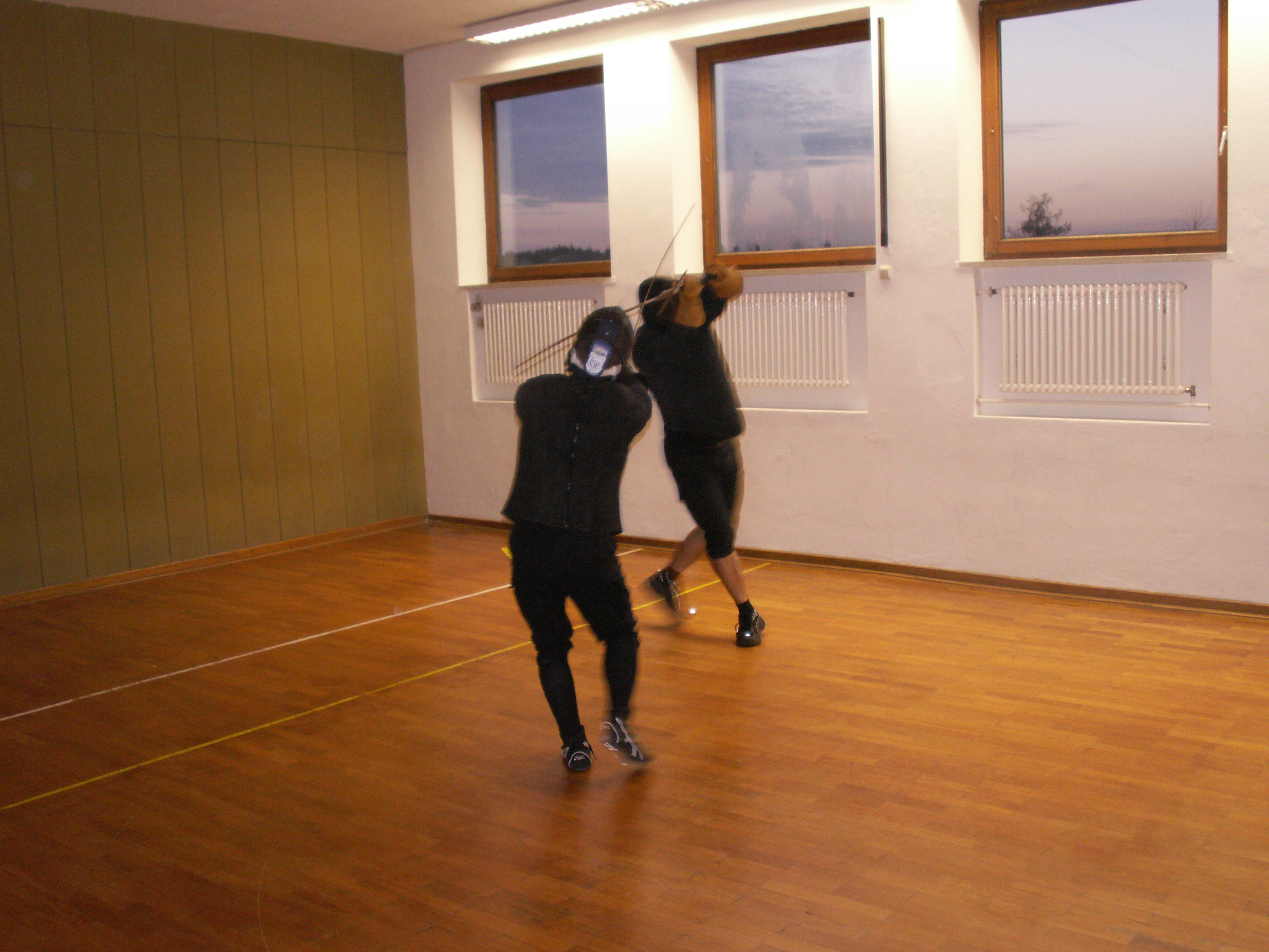 Two longsword fencers in action!